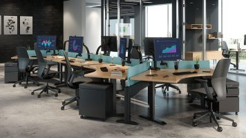 Ella monitor arms on HAT height adjustable tables.